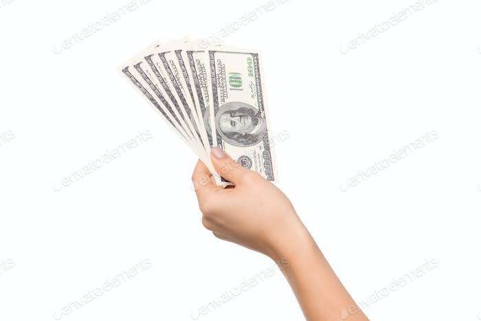 Frau Hand halten Haufen Dollar Scheine