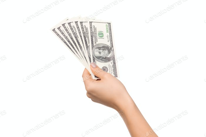 Woman hand holding pile of dollar bills