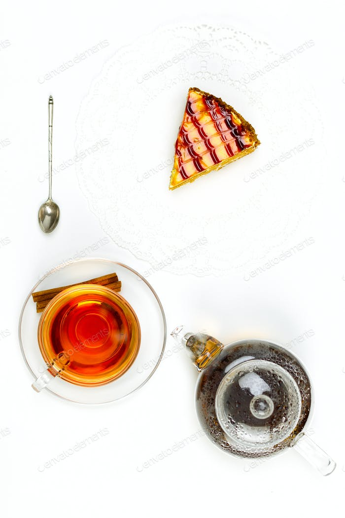 Transparent teapot, glass cup, spoon