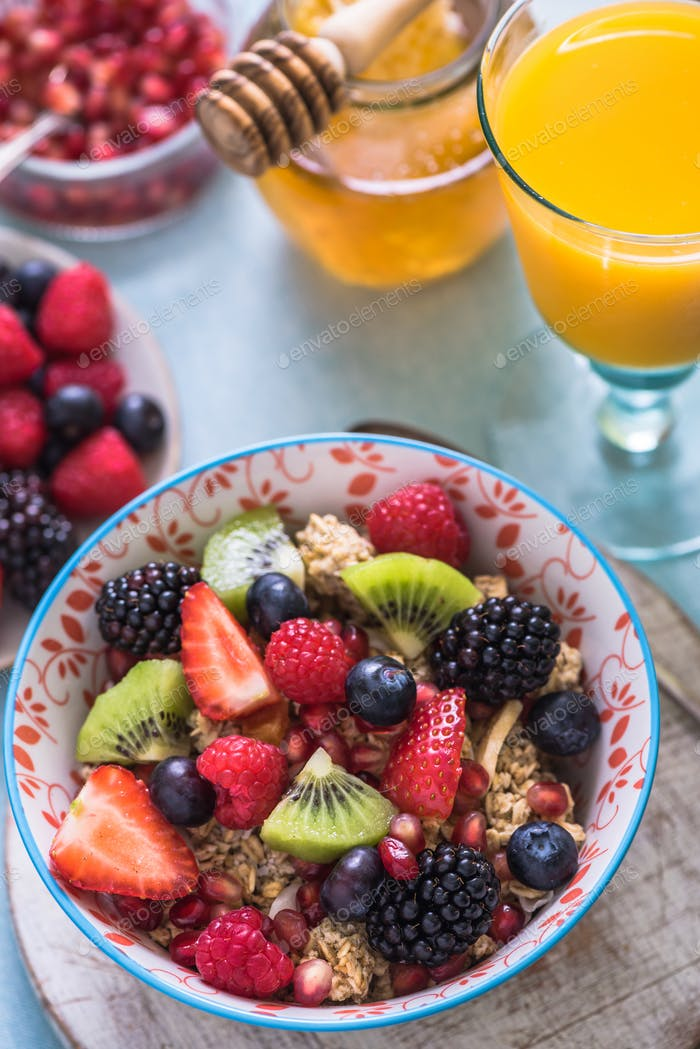 cereal bowl with fresh mixed fruits, overhead