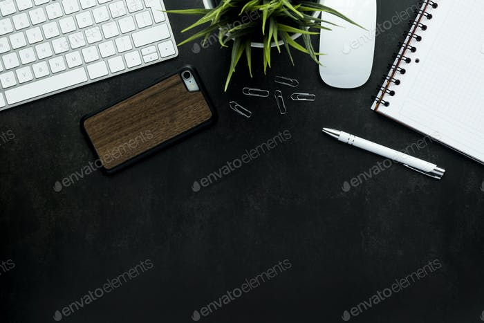 Work space with black desk, top view