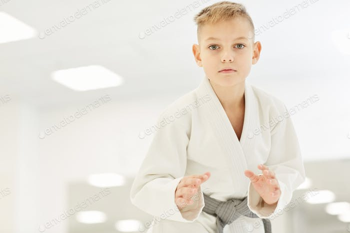 The boy standing in a fighting stance
