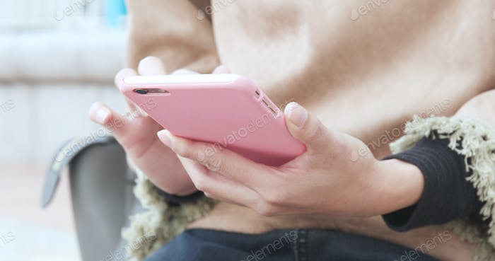Woman use of smart phone in city