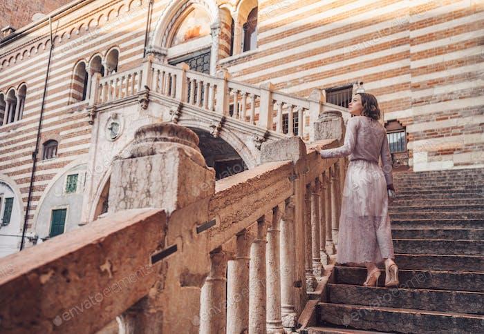 Beautiful girl in a dress in Verona