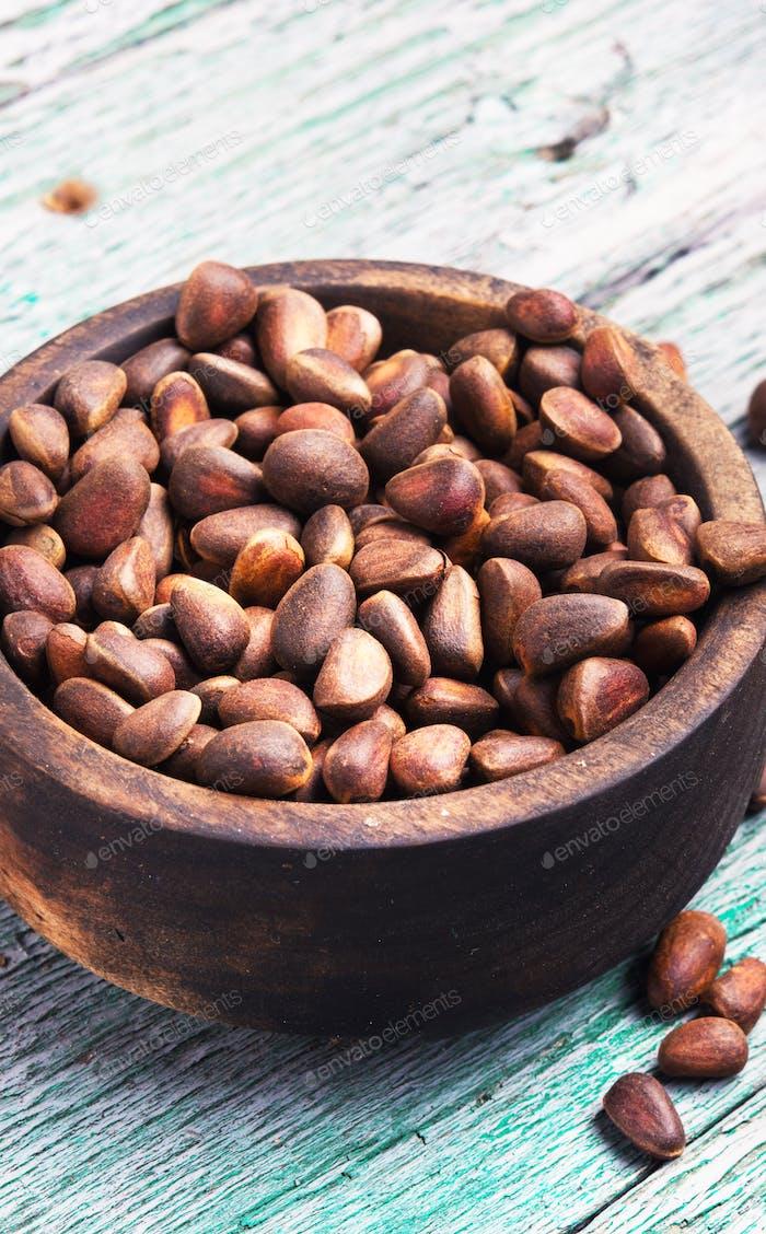 unpeeled cedar nut in mortar