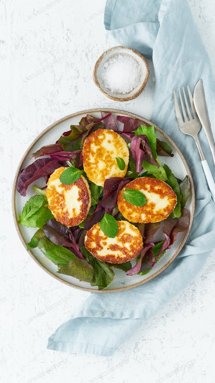 Cyprus fried halloumi with salad mix, beet tops. Lchf, pegan, fodmap, paleo, scd, keto