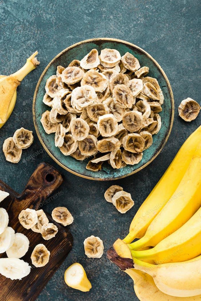 Dried banana chips and fresh bananas
