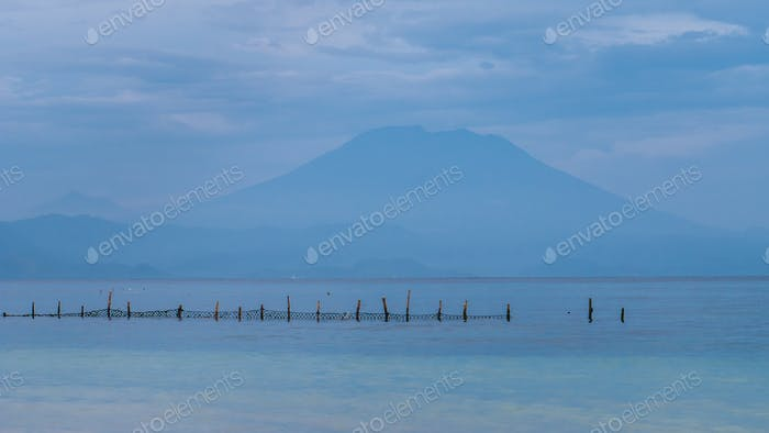 Beautifull evening view to St. Agung Vulcano on Bali from Nusa Penida Island, Net in front some