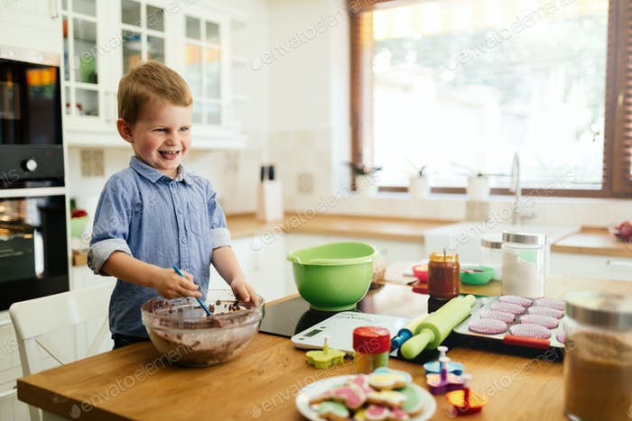 Cute child learning to become a chef since the age of 2
