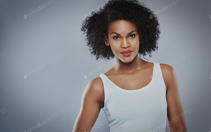 Cute young serious Black woman