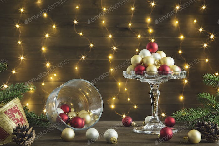Refined Christmas composition with glass balls reds golden and silver in a glass cake stand