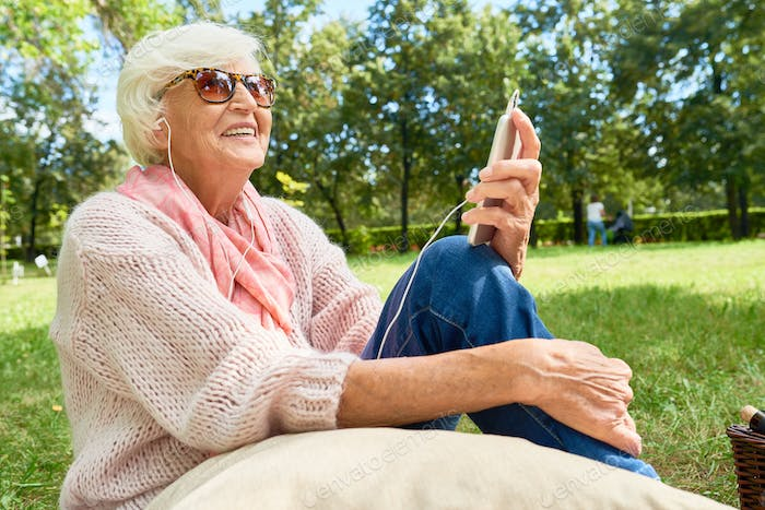 Senior Woman with Smartphone Outdoors