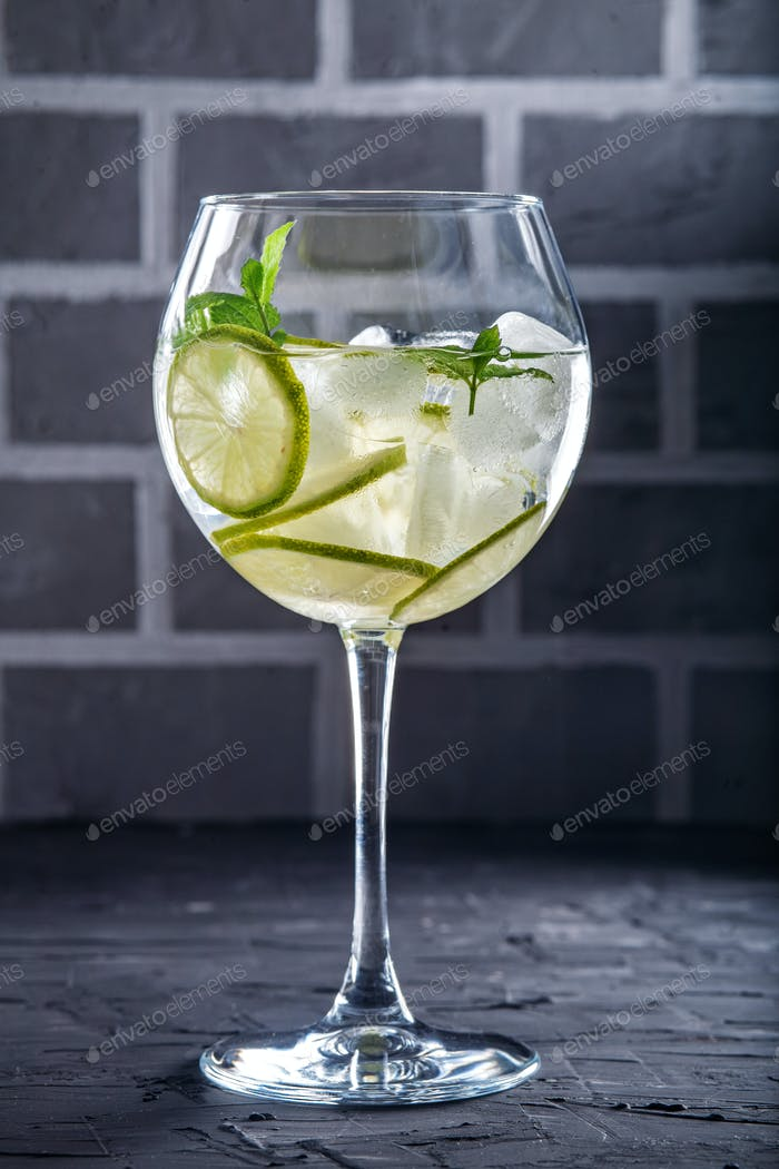 Cocktail with lime and mint. Concept of drinks and alcohol.