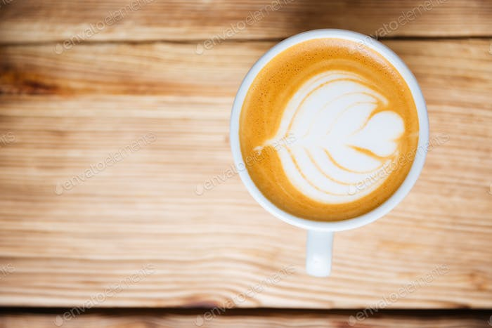 Top view of a cup with cappucino