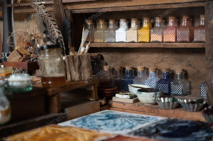 color painter artist's workspace, water color tools on desk of painter.