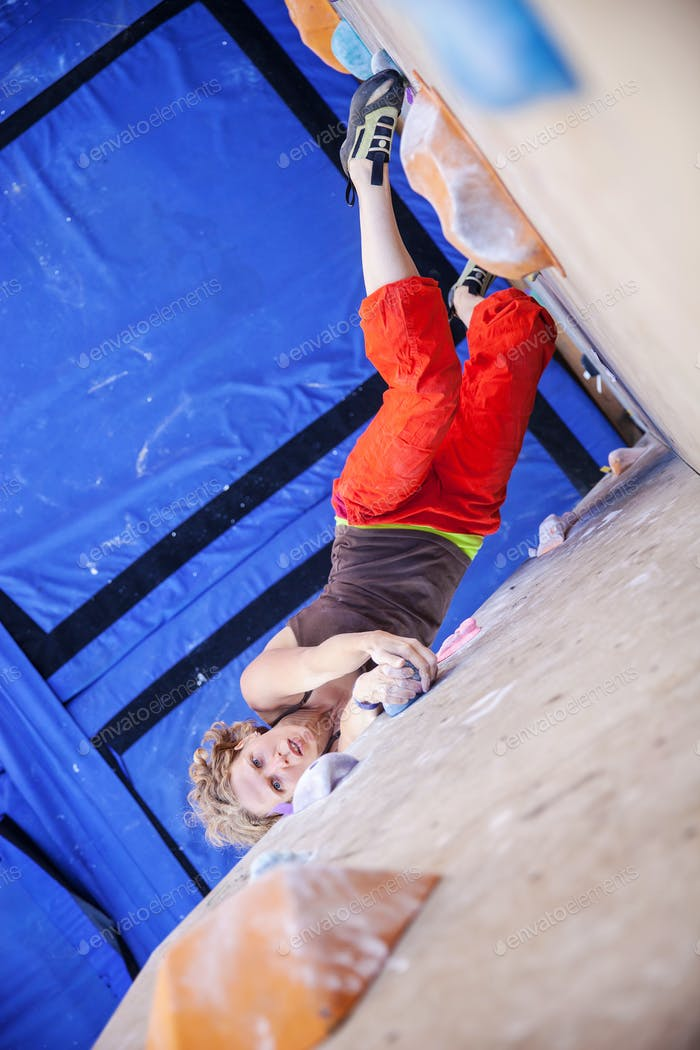 Female climber on artificial climbing wall