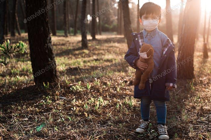Kid and teddy bear using air masks