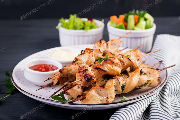 Chicken shish kebab. Shashlik - grilled meat and fresh vegetables.