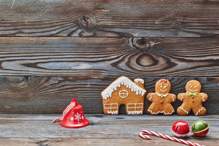 Christmas homemade decoration, gingerbread house and couple - man and woman.