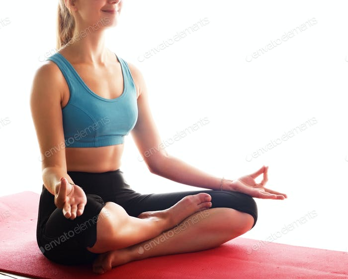 Young happy woman doing yoga sitting meditation. Healthy lifesty