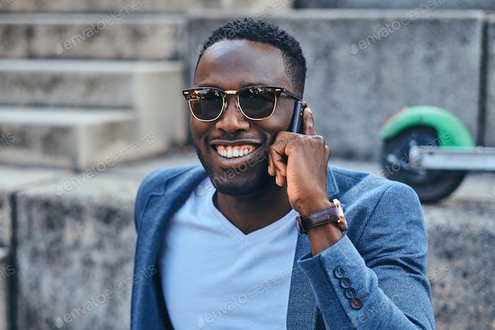 Portrait of attractive black man in sunglasses