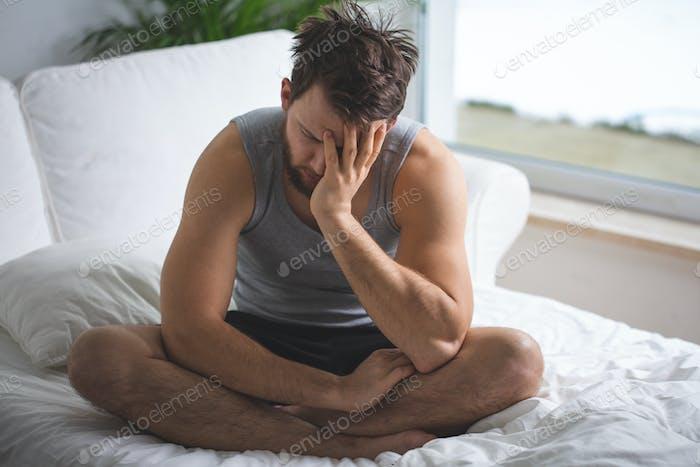 Worried man in bed
