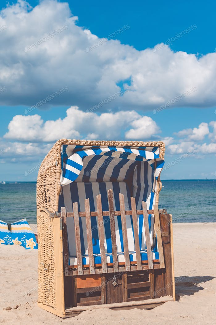 Locked beach roofed chairs in Travemunde. Nice Clouds in the sky. Germany