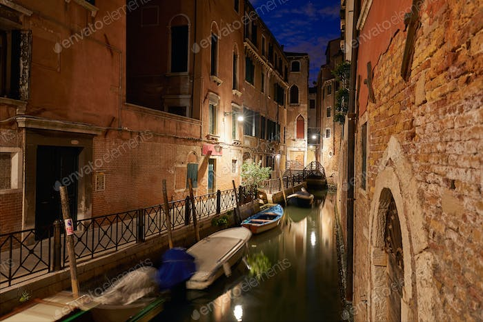 Venice canal at night, buildings and houses facades in Italy