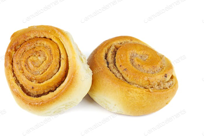 Sweet homemade cinnamon rolls isolated on white background