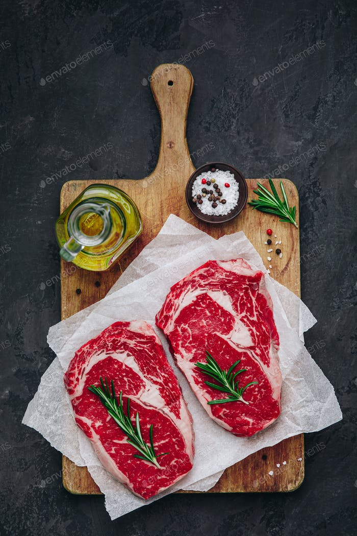 Ribeye Steak, Raw fresh beef meat with salt and rosemary ready for barbecue