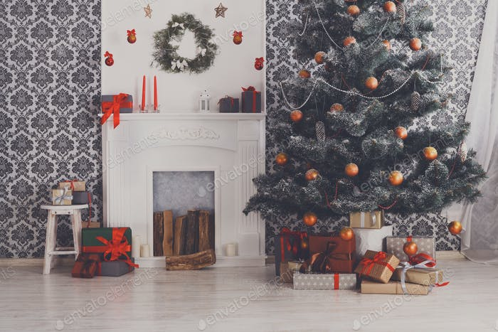 Beatiful christmas decorated tree in modern interior, holiday concept