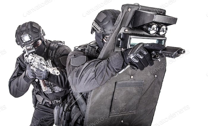 SWAT team behind ballistic shield studio shoot