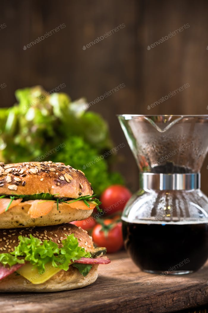 Fresh healthy bagels and coffee in dipper