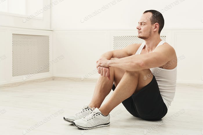 Male bodybuilder having rest after workout