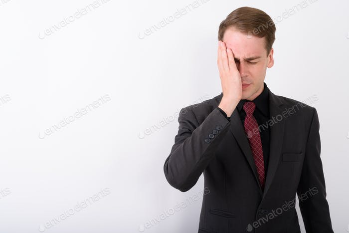 Thumbnail for Young handsome businessman wearing suit against white background