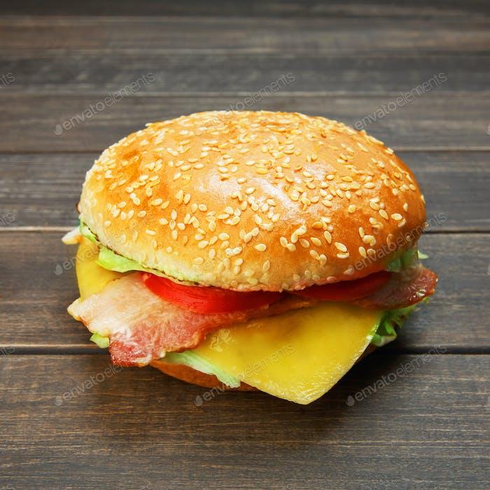 Bacon and cheese burger at rustic wood