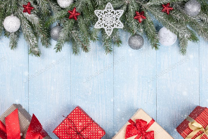 Christmas and New Year background with decorated fir branches and gift boxes