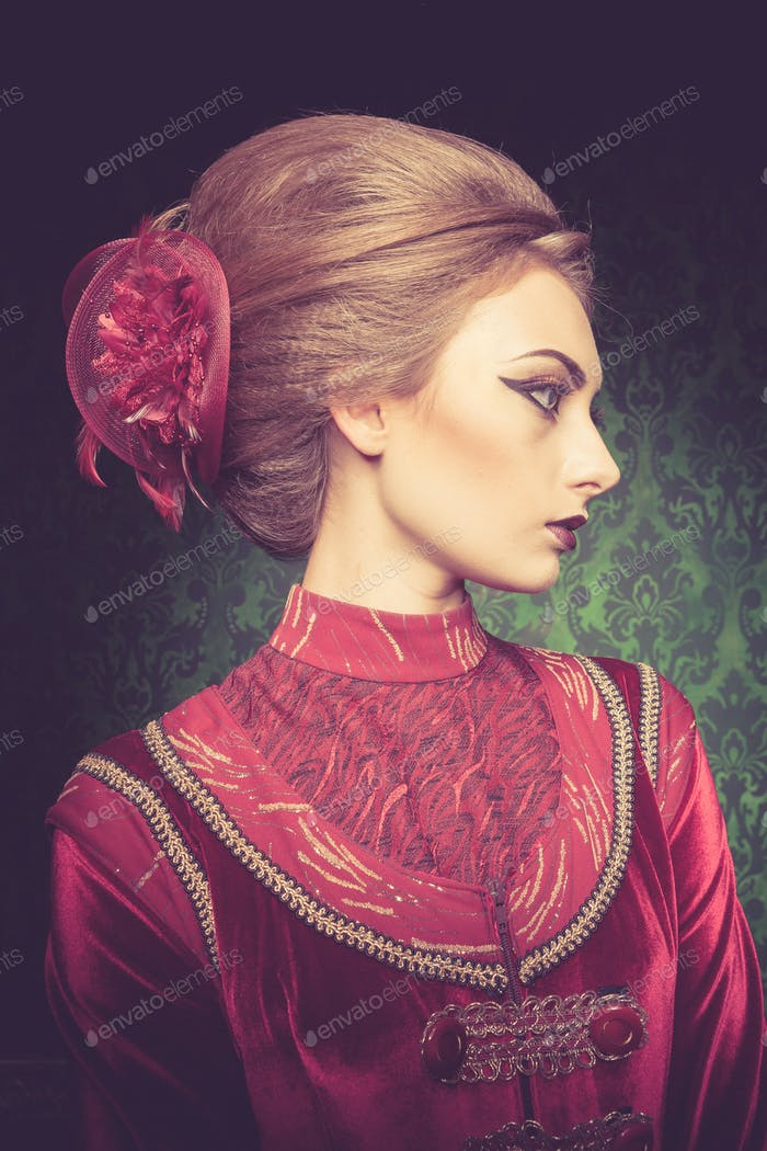 Portrait of beautiful woman dressed vintage clothes in retro int