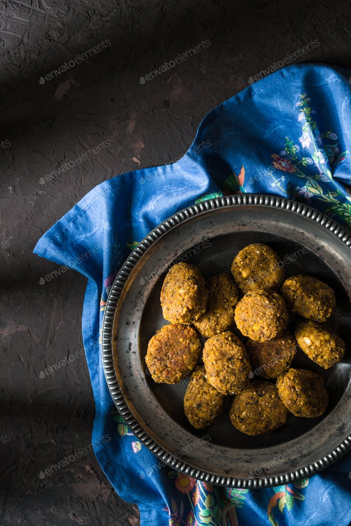Vegetarian falafel on a tin plate on a blue napkin free space