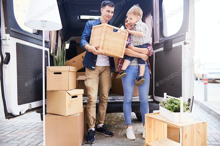 Happy Young Family Moving In