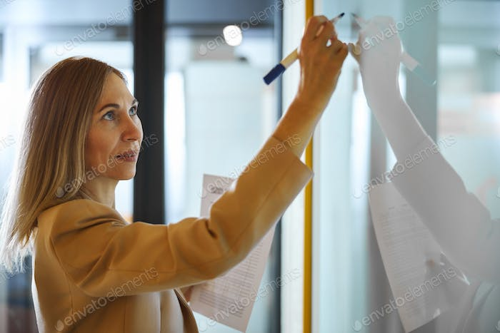 Kind businesswoman working in the conference hall