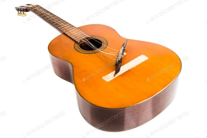 Broken classical guitar with detached bridge isolated in white b