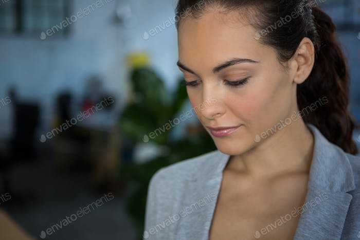Close-up of businesswoman in office