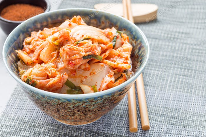 Kimchi cabbage. Korean appetizer in bowl, horizontal, copy space