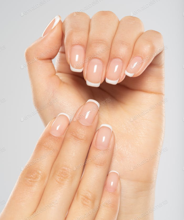 Beautiful female hands. Woman hands with beautiful french manic