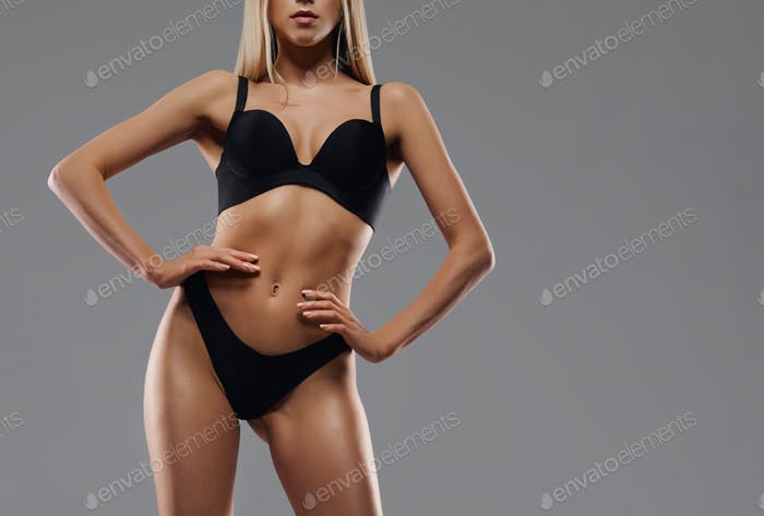 Crop of woman in lingerie isolated on grey