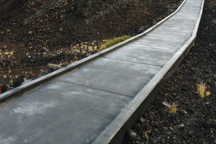 A paved pathway up into the lava fields of the Craters of the Moon, Idaho.