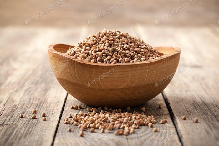 Buckwheat groats in wooden bowl