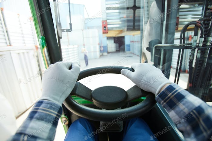 Truck driver at steering wheel