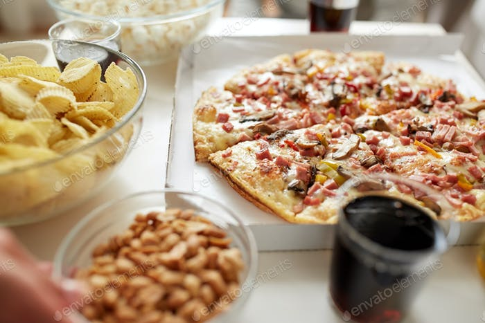 pizza and other fast food snacks on table